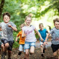 Kids running in the woods